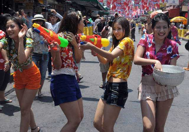 Thai teenagers enjoy a water battle with